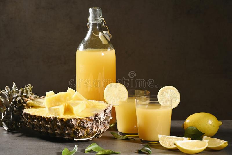 Bottle of homemade pineapple juice with ginger, lemon and ingredients. royalty free stock photos
