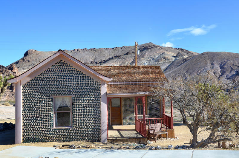 Bottle House in Rhyolite, Nevada, USA. RHYOLITE, USA - Dec. 15 2015: 'Bottle House' under blue sky. A ghost town next to Death Valley and Beatty, Nevada royalty free stock photography