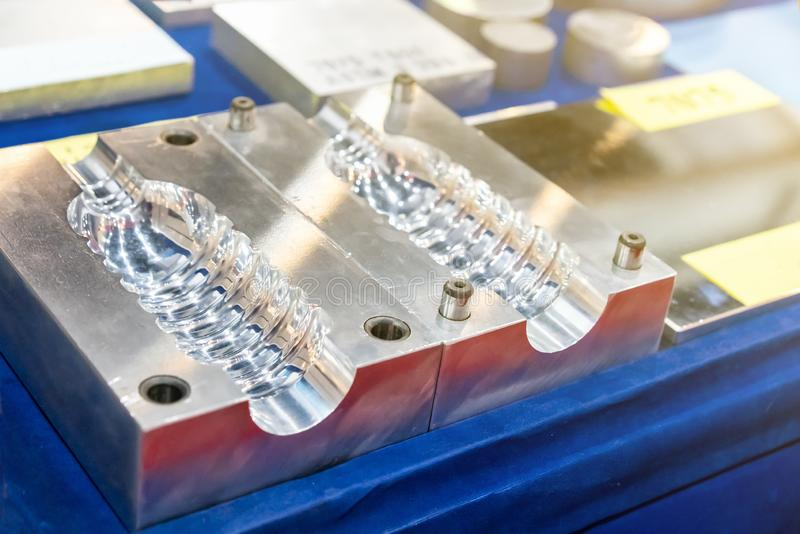 Bottle injection or blowing plastic mold for mass production industrial made from high accuracy machine royalty free stock photo