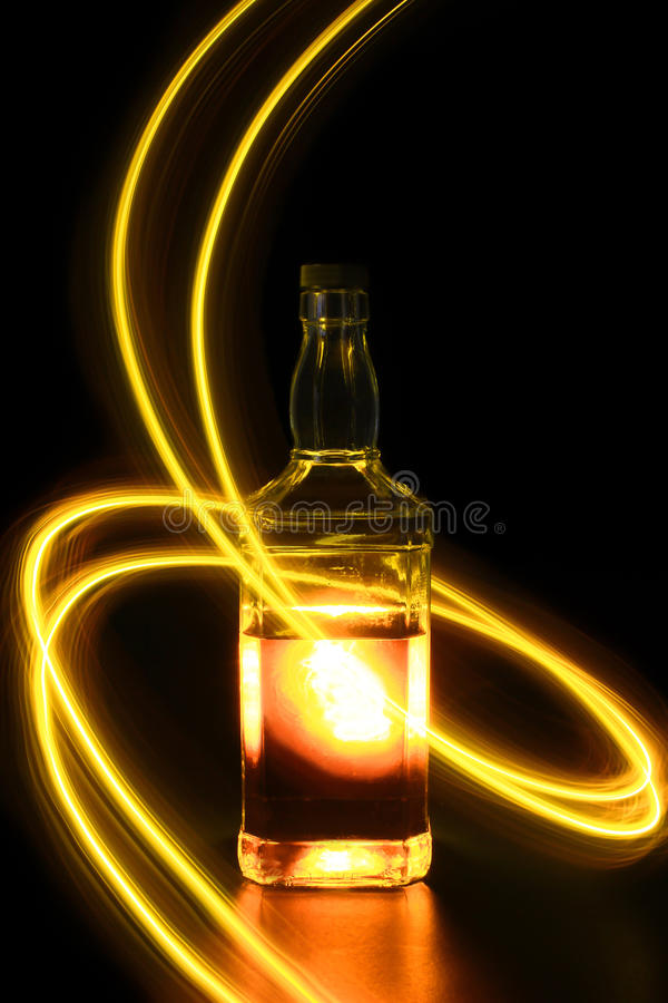 Bottle with light painting 3. A bottle with a coloful light painting royalty free stock image