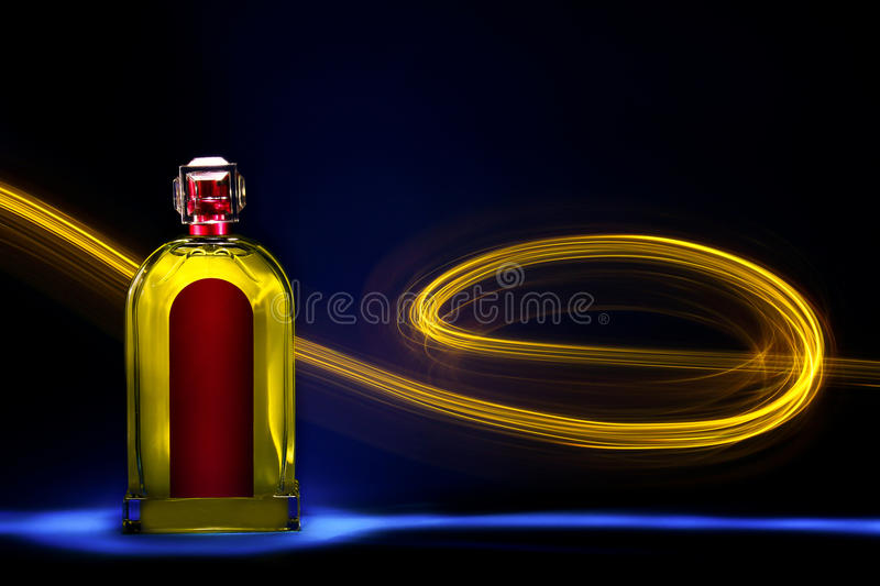Bottle with light painting 4. A bottle with a coloful light painting stock image