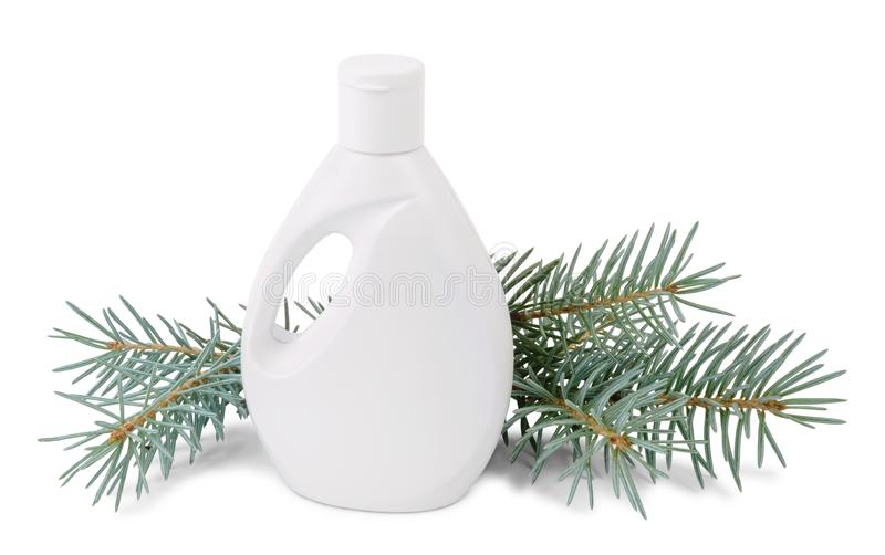 Bottle of liquid soap and fir branches on white stock photography