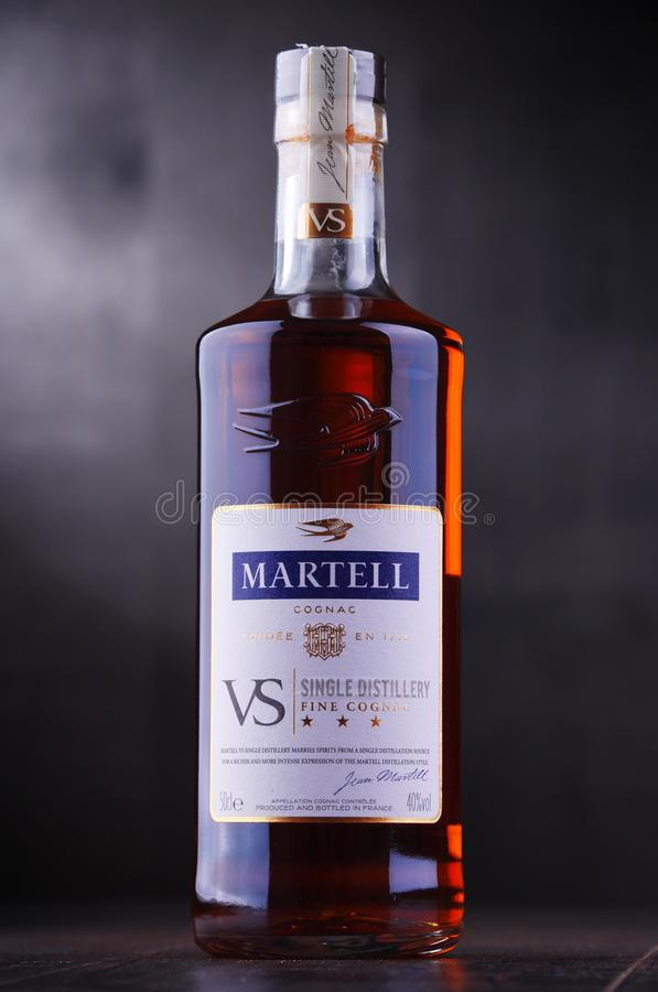 Bottle of Martell Cognac. POZNAN, POL - SEP 27, 2018: Bottle of Martell Cognac, a brand founded in 1715 by Jean Martell, now owned by French wines and spirits stock photos