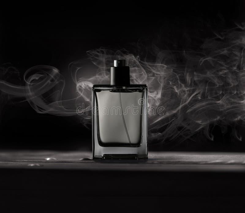 Bottle of men`s Fragrance. On a dark background stock photos