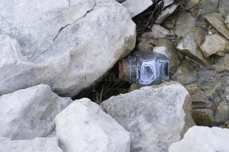 Bottle with message floating in lake stock image