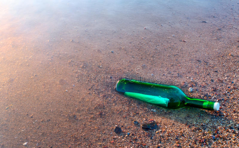 Bottle with the message on sea coast royalty free stock image