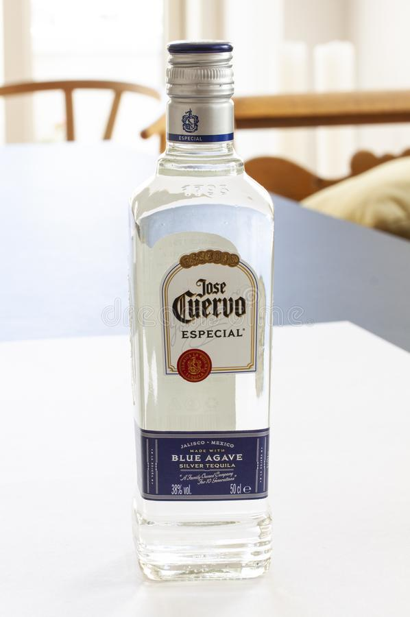Bottle of Mexican tequila on a table in home environment stock images