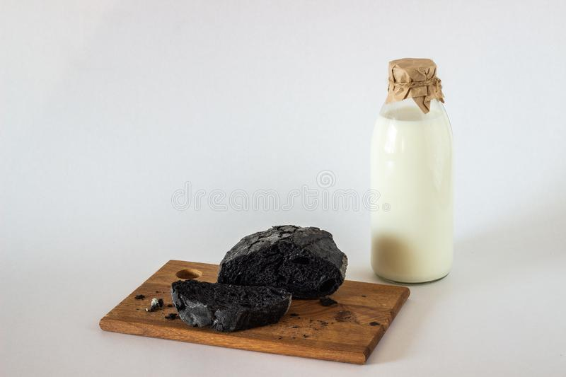 A bottle of milk and bread. White background stock image
