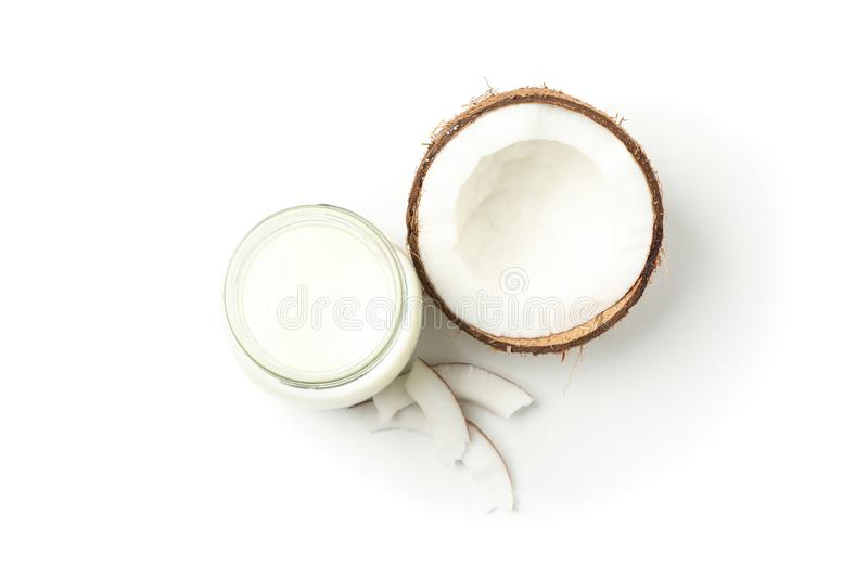 Bottle of milk, coconut and slice coconut isolated on background. Top view. Bottle of milk, coconut and slice coconut isolated on white background. Top view royalty free stock image