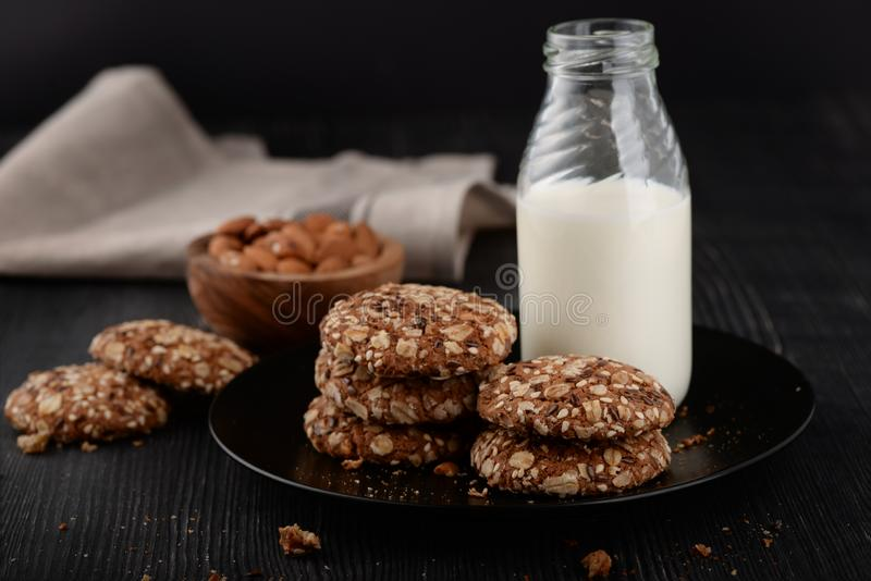 Bottle of milk and homemade whole grain cookies royalty free stock photos