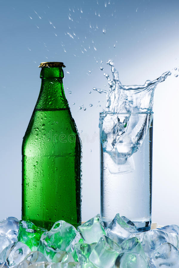 Bottle of mineral water with ice royalty free stock photography