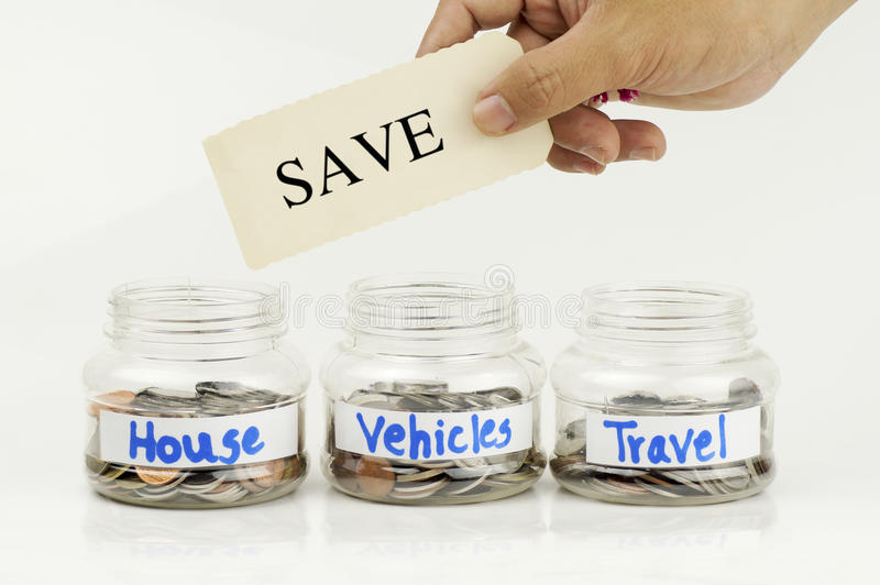 Bottle of money for save for house and vehicles and travel with. Hand holding and showing sign of save stock photo