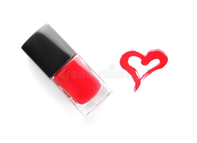 Bottle of nail polish with drawn heart on white background stock images