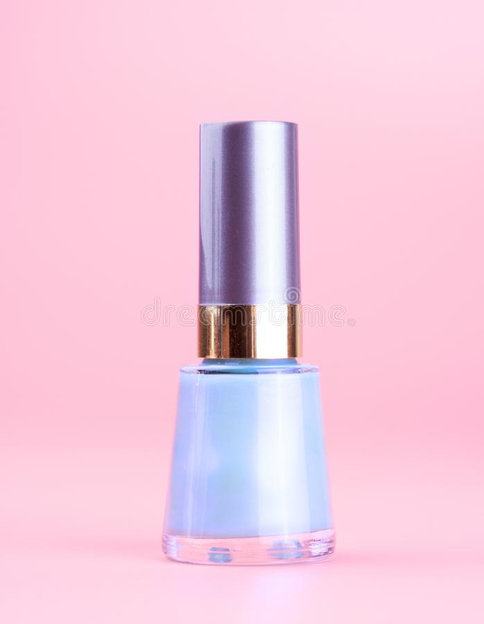Bottle of nice pearly blue nail polish stock images