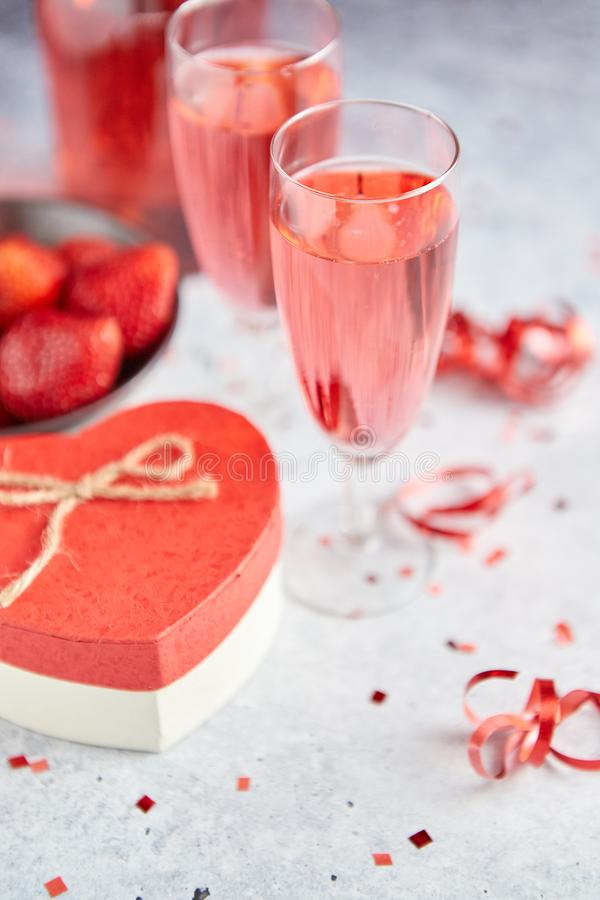 Free Bottle Of Rose Champagne, Glasses With Fresh Strawberries And Heart Shaped Gift Stock Image - 133810461
