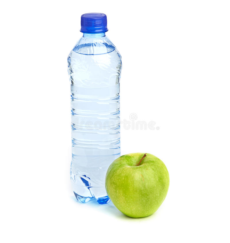 Free Bottle Of Sparkling Water And Green Apple Stock Image - 34558751