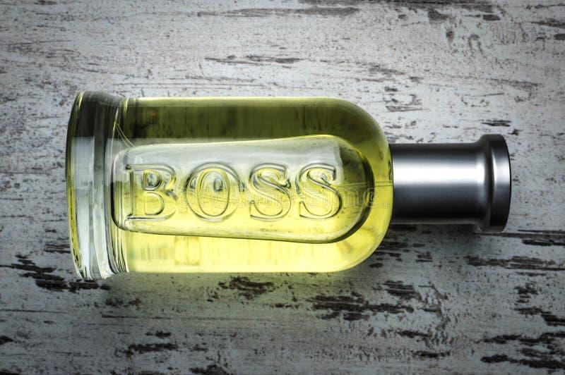 Bottle package of grey BOSS Bottled fragrance for men by Hugo Boss stock photography