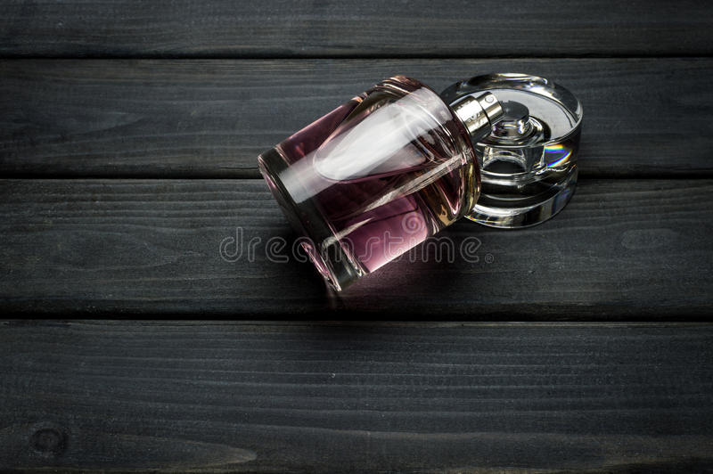 A bottle package of pink BOSS Femme fragrance for women by Hugo Boss royalty free stock photos
