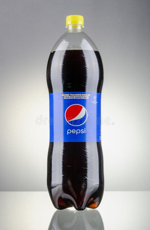 Bottle of Pepsi drink isolated on gradient background. Pepsi is carbonated soft drink produced by PepsiCo. Pepsi was created and developed in 1893 royalty free stock photography