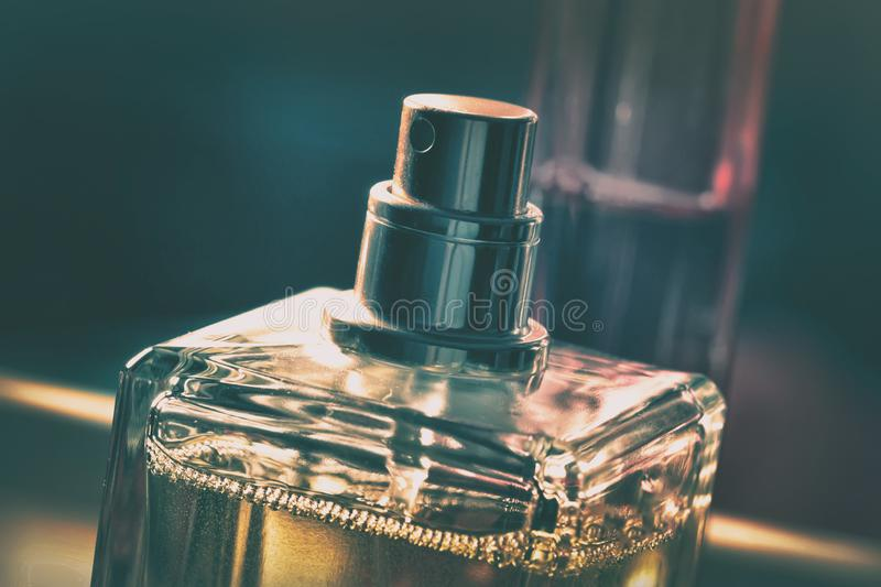 Bottle of perfume. In gold tones royalty free stock photography