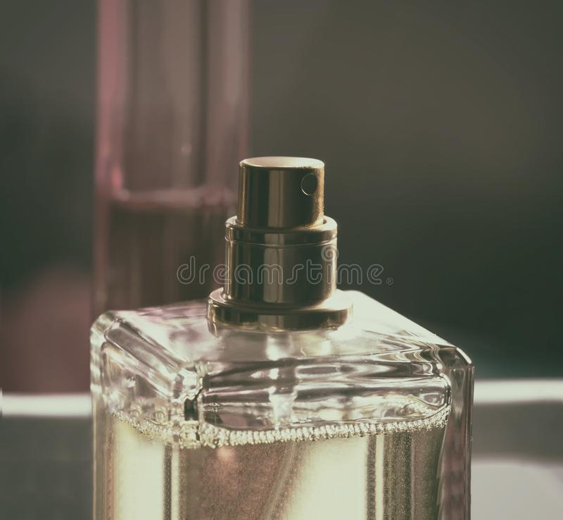 Bottle of perfume. In gold tones royalty free stock photos