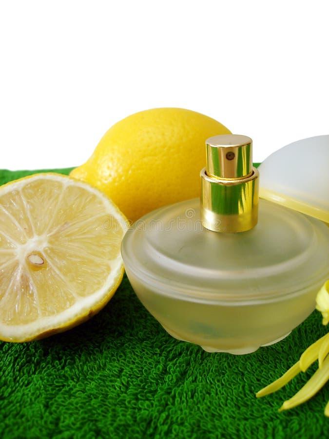 Bottle of perfume with lemon