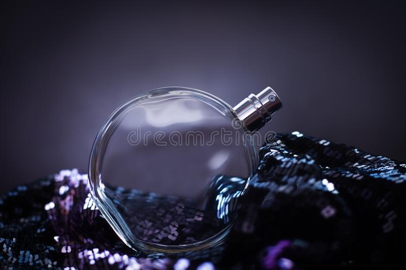 Perfume on sequin. Bottle of perfume on sequin stock images