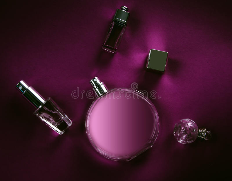 Bottle with perfumes. On a pink background royalty free stock photos