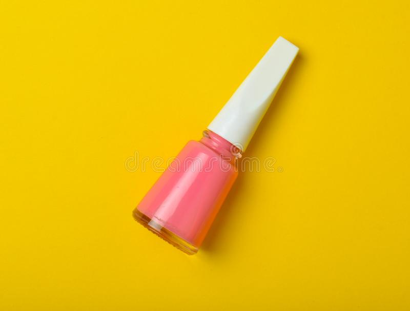 A Bottle Of Pink Nail Polish On A Bright Yellow Background. Top View ...