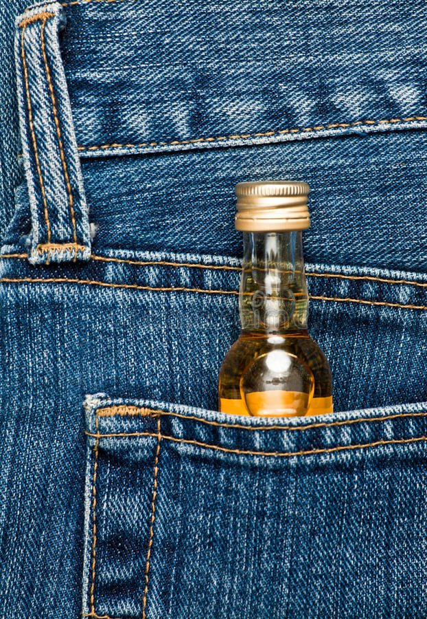 Bottle in a pocket royalty free stock images
