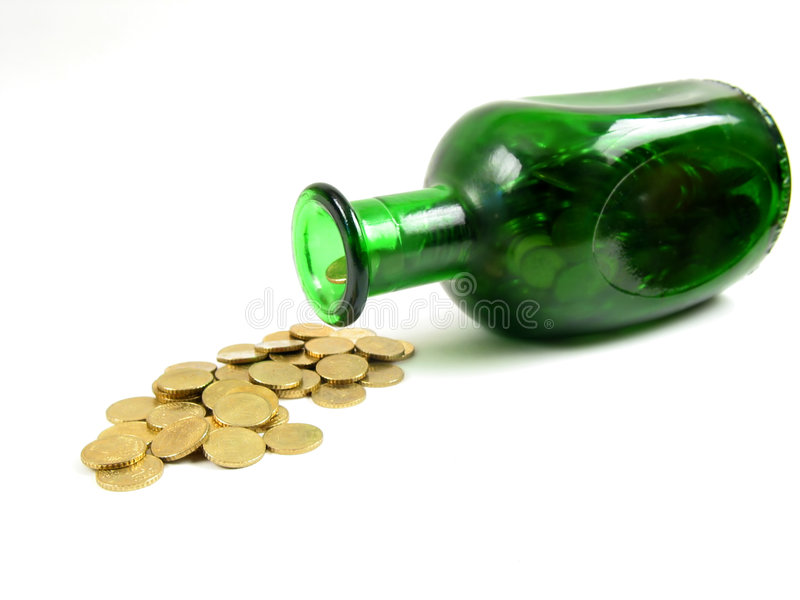 Bottle pouring gold (side view) stock images