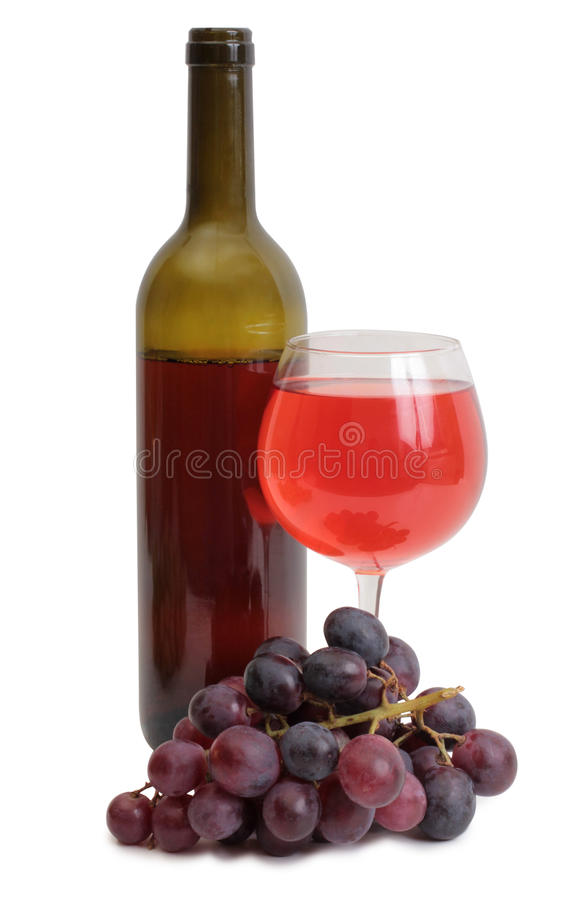 Bottle and red grapes on white royalty free stock image
