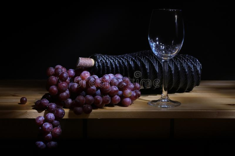 Grape glass and bottle of wine stock photos