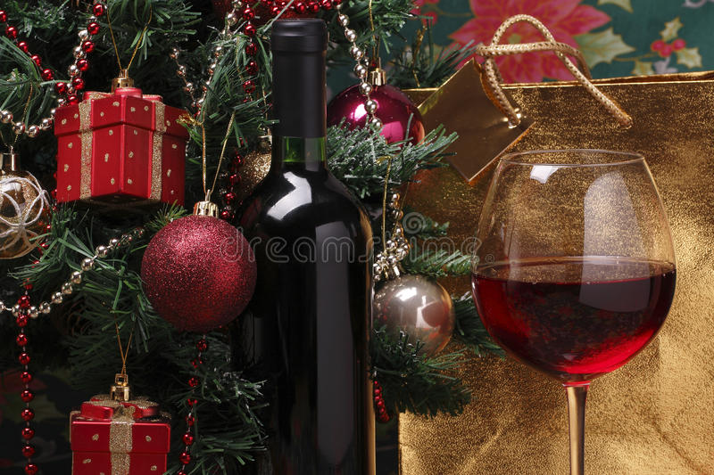 Bottle of red wine on the and christmas tree stock image