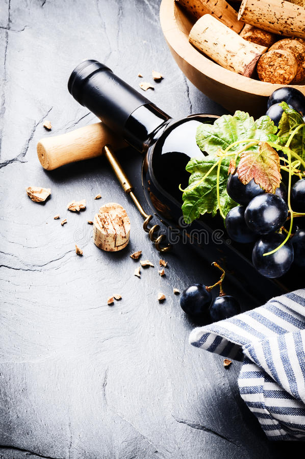 Bottle of red wine with fresh grape stock photo