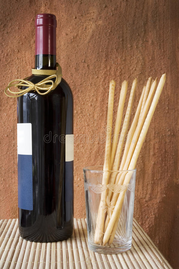 Bottle of red wine with italian pastry royalty free stock images