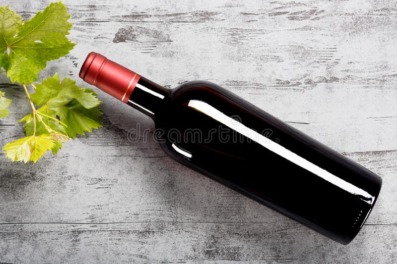 Bottle of red wine on the table. Top view stock images