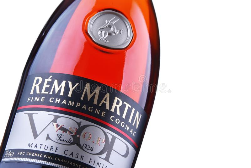 Bottle of Remy Martin cognac over white background. POZNAN, POL - JUN 30, 2018: Bottle of Remy Martin, the brand that specialises in Cognac Fine Champagne stock image