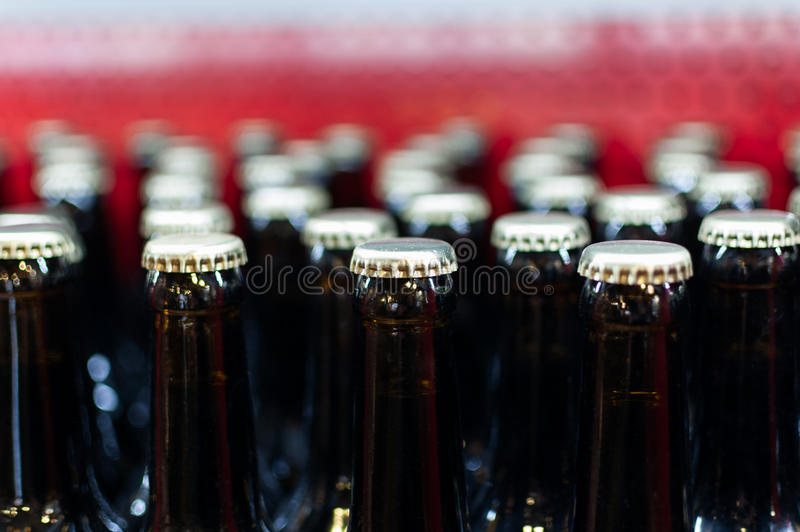 Bottle rows. With metal caps stock images