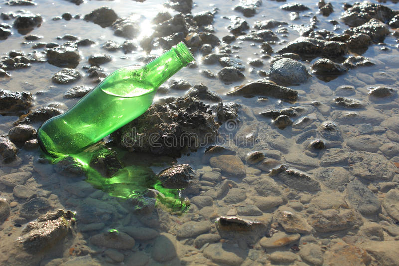 A Bottle by the Sea stock photography