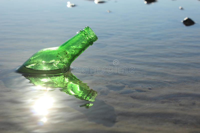 A Bottle by the Sea stock images