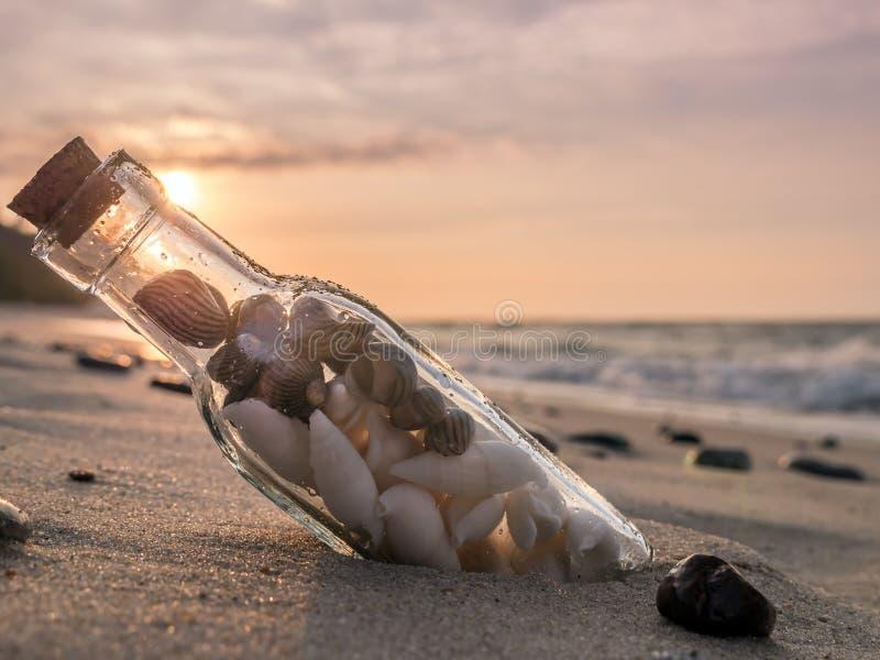 Bottle with seashells stock photo