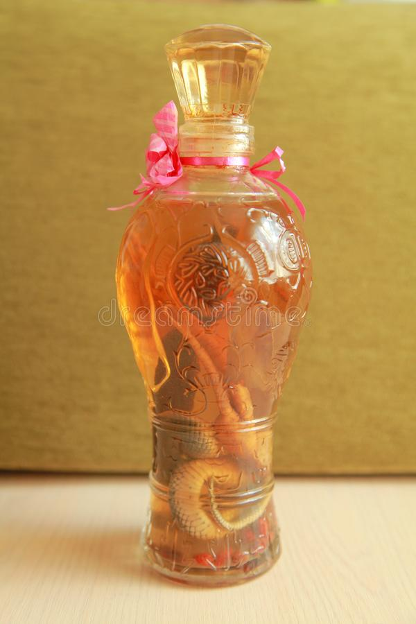 Bottle of snake whisky for sale on the table stock photography