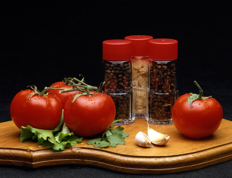 Of bottle with spices and tomato royalty free stock photo