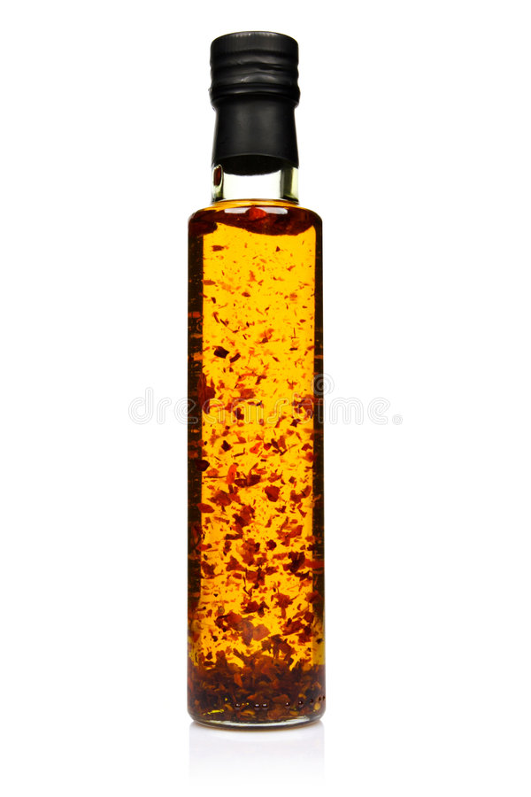 Bottle of spicy olive oil. Bottle of spicy olive oil with chilli pepper stock images