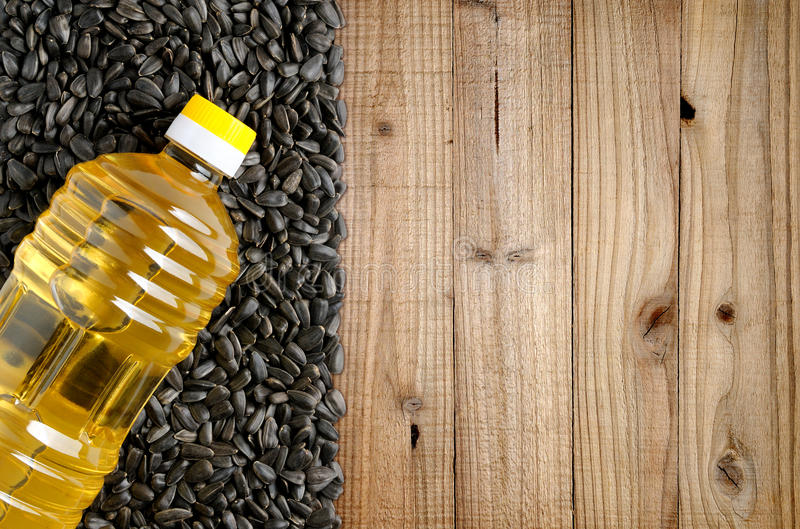 Bottle of sunflower oil and sunflower seeds royalty free stock image