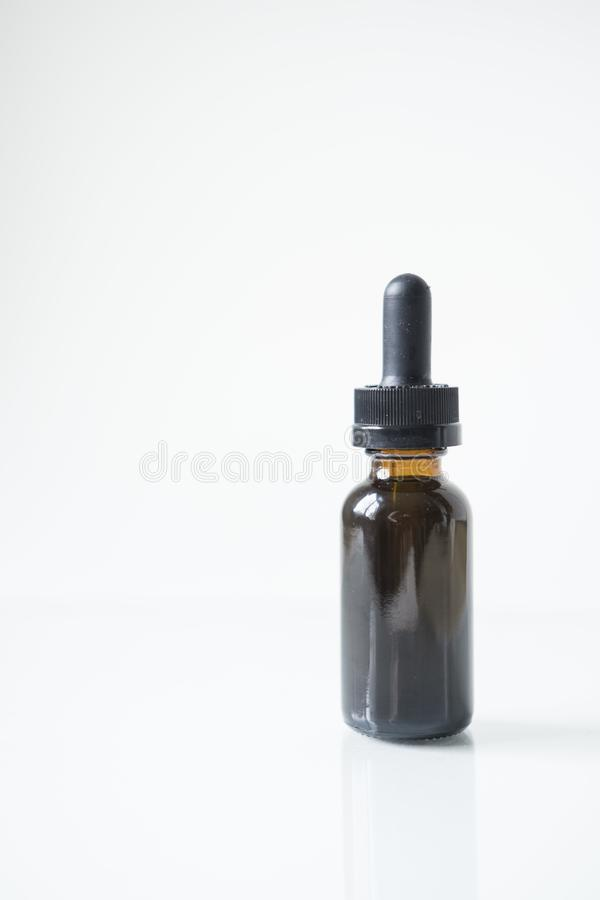 Tincture bottle isolated with reflection stock images