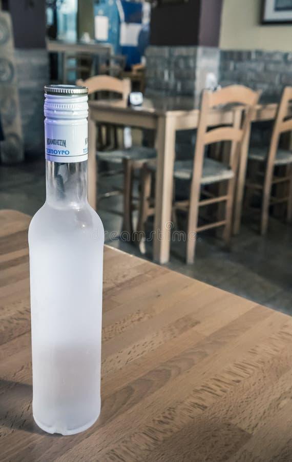 Bottle of tsipouro stock photo