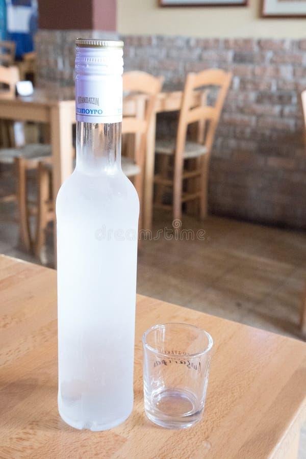 Bottle of tsipouro royalty free stock photo