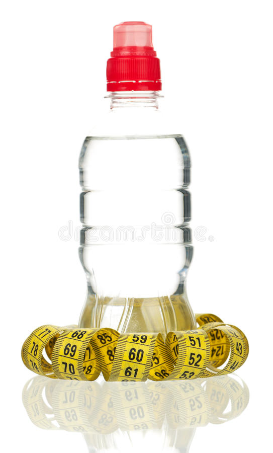 Bottle of water. With tape measure isolated on white royalty free stock photo